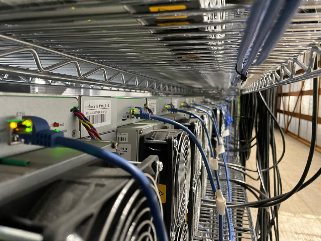 Photo of Hardin, Montana data center. Close-up on miners.